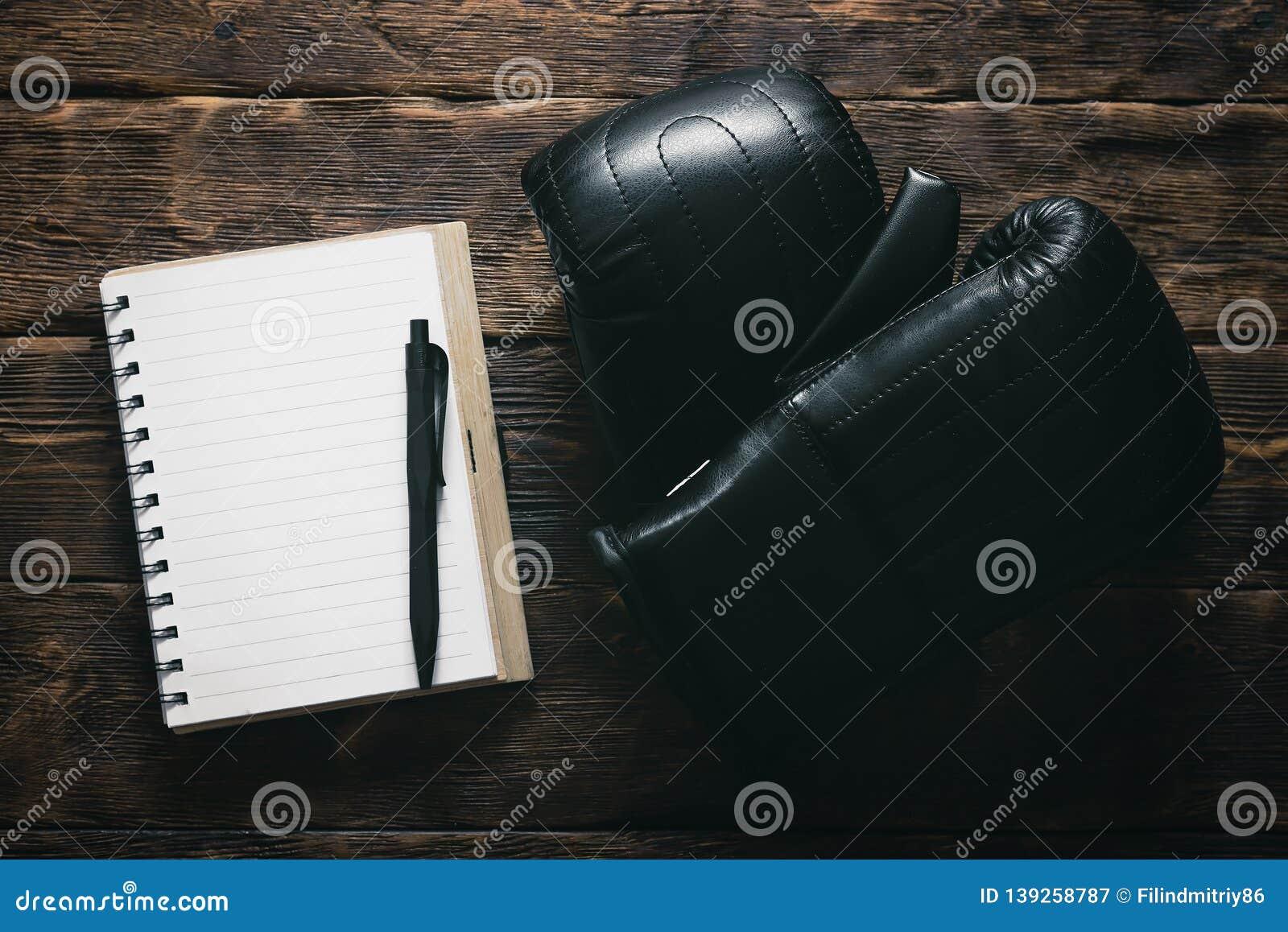 Boxing Gloves And Training Program Notepad  Stock Image