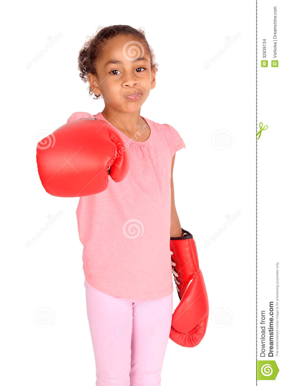 Little girl with boxing gloves.