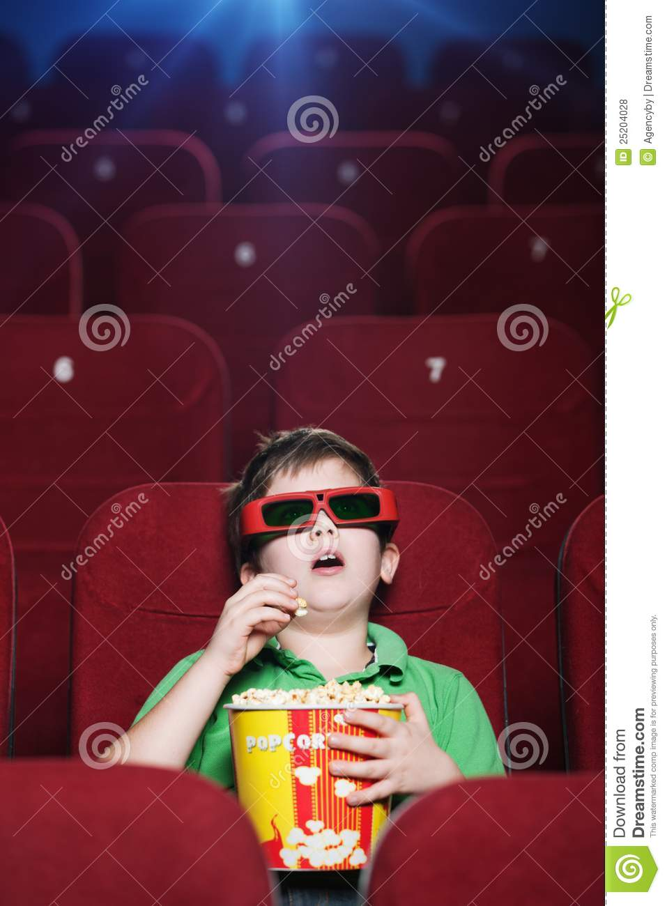 A boy at the 3D cinema