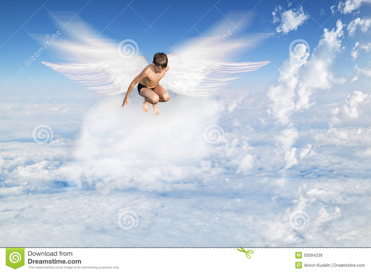 boy with angel wings flying around in the sky stock photo image