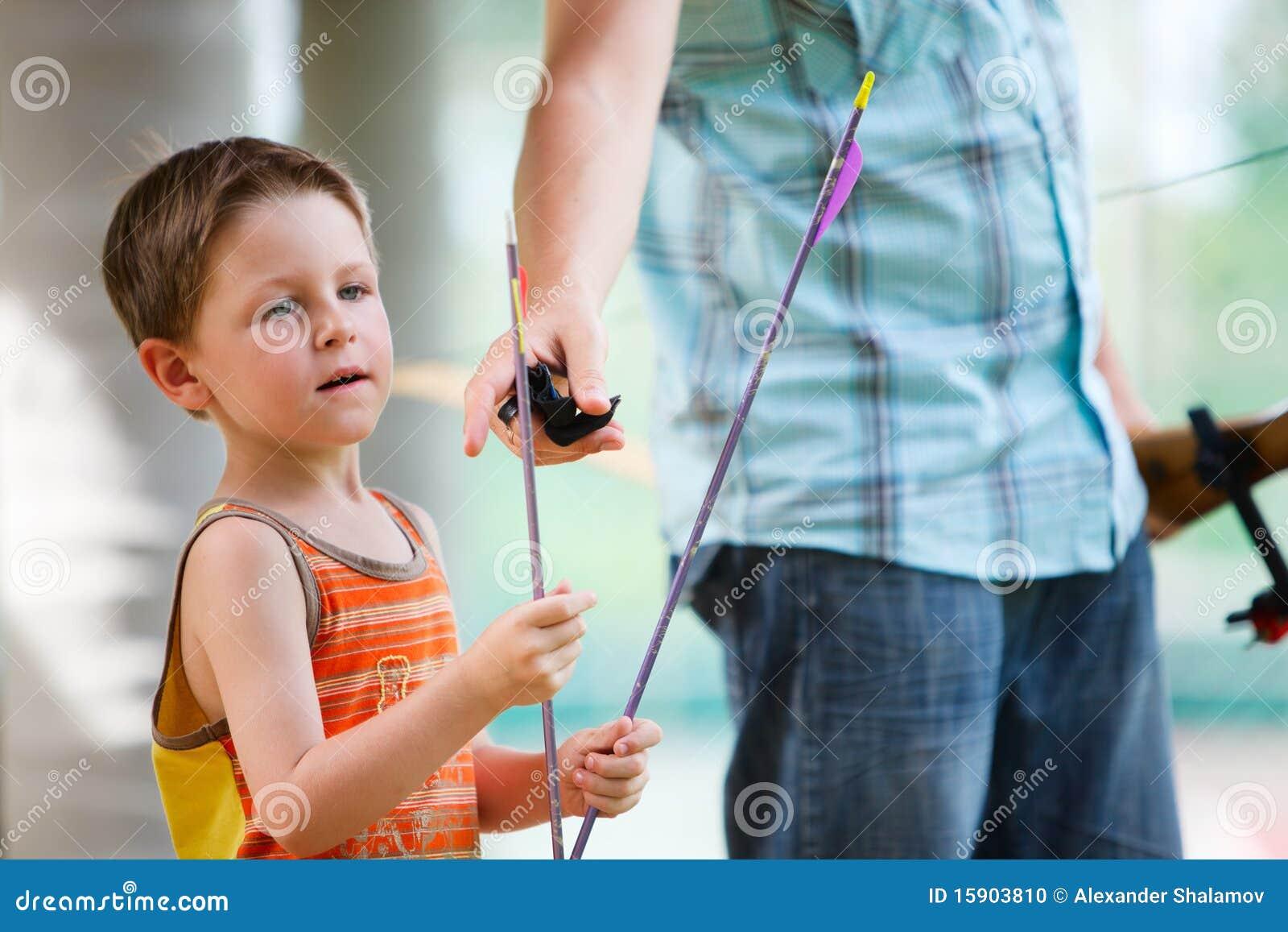 Boy with archery arrows