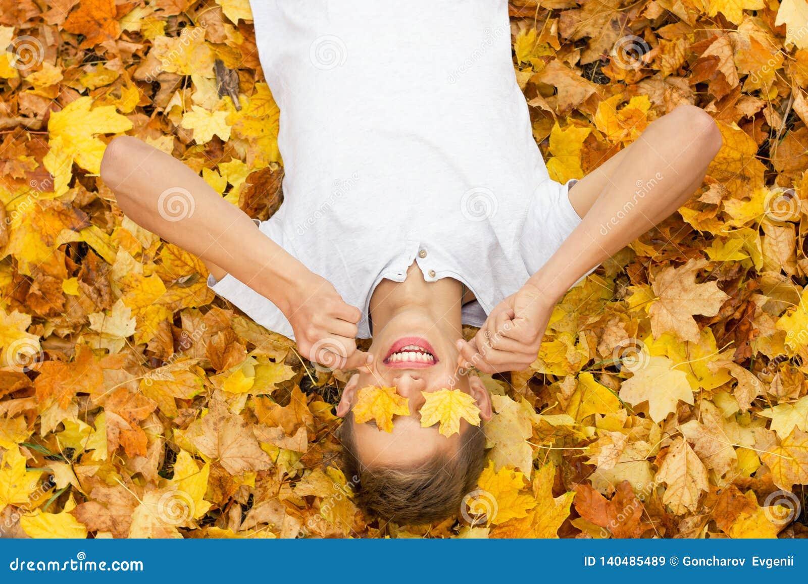 Boy in autumn leaves ,