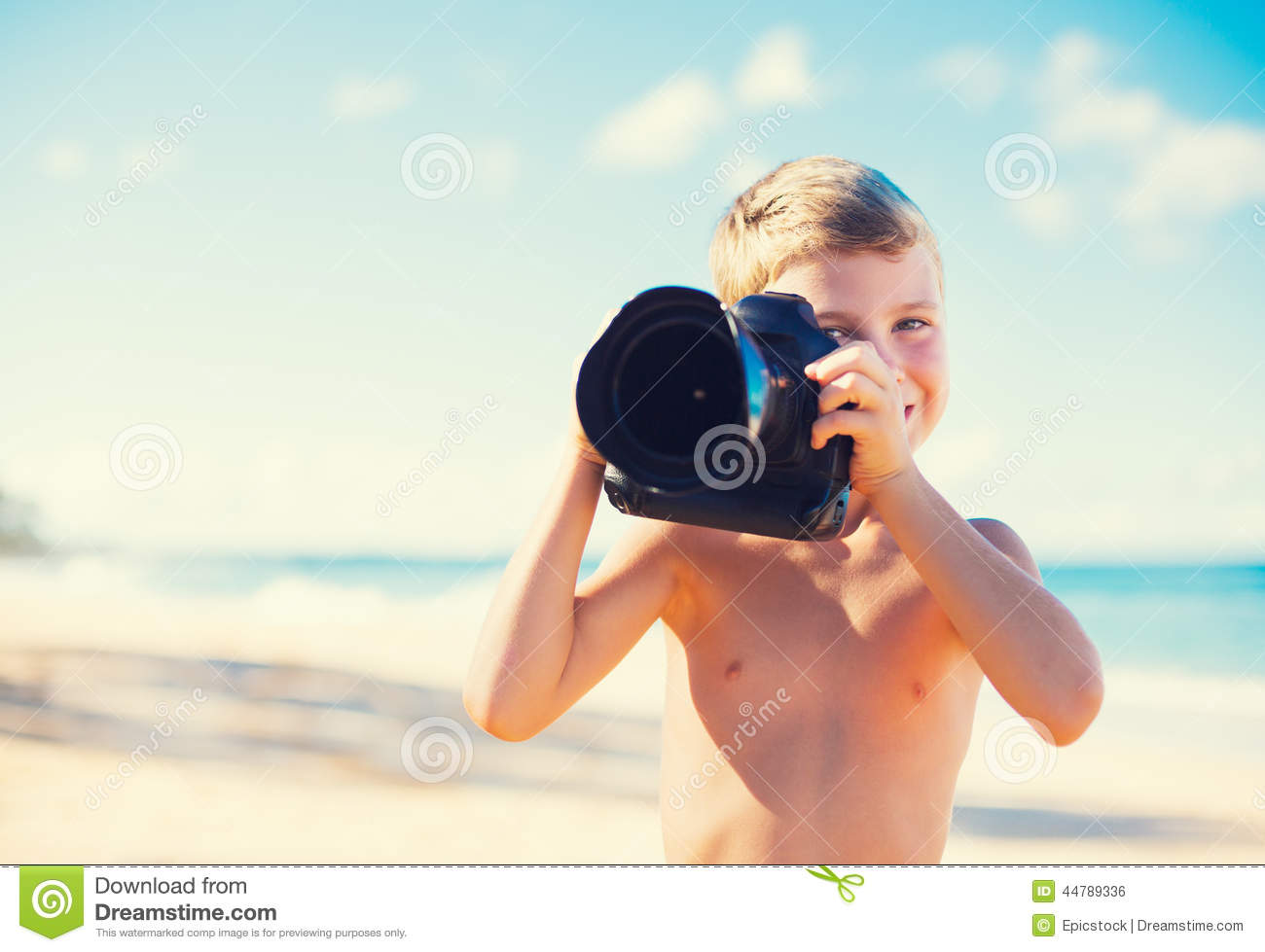 Boy On The Beach With Camera Stock Photo - Image: 44789338