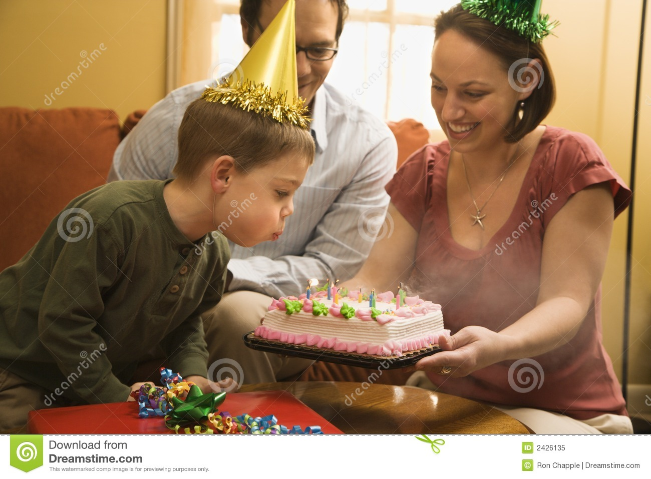 Boy with birthday cake.