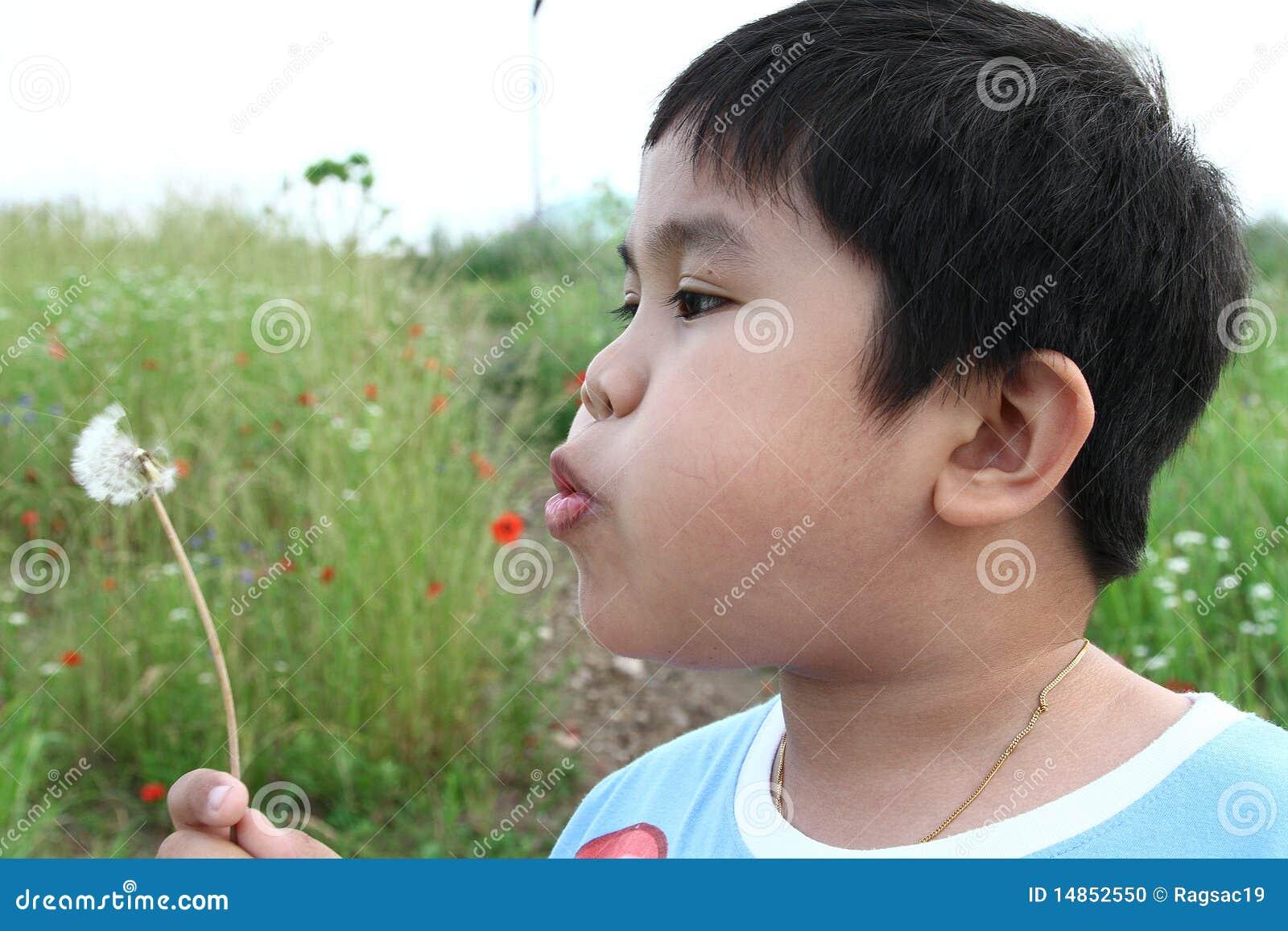 Boy blowing