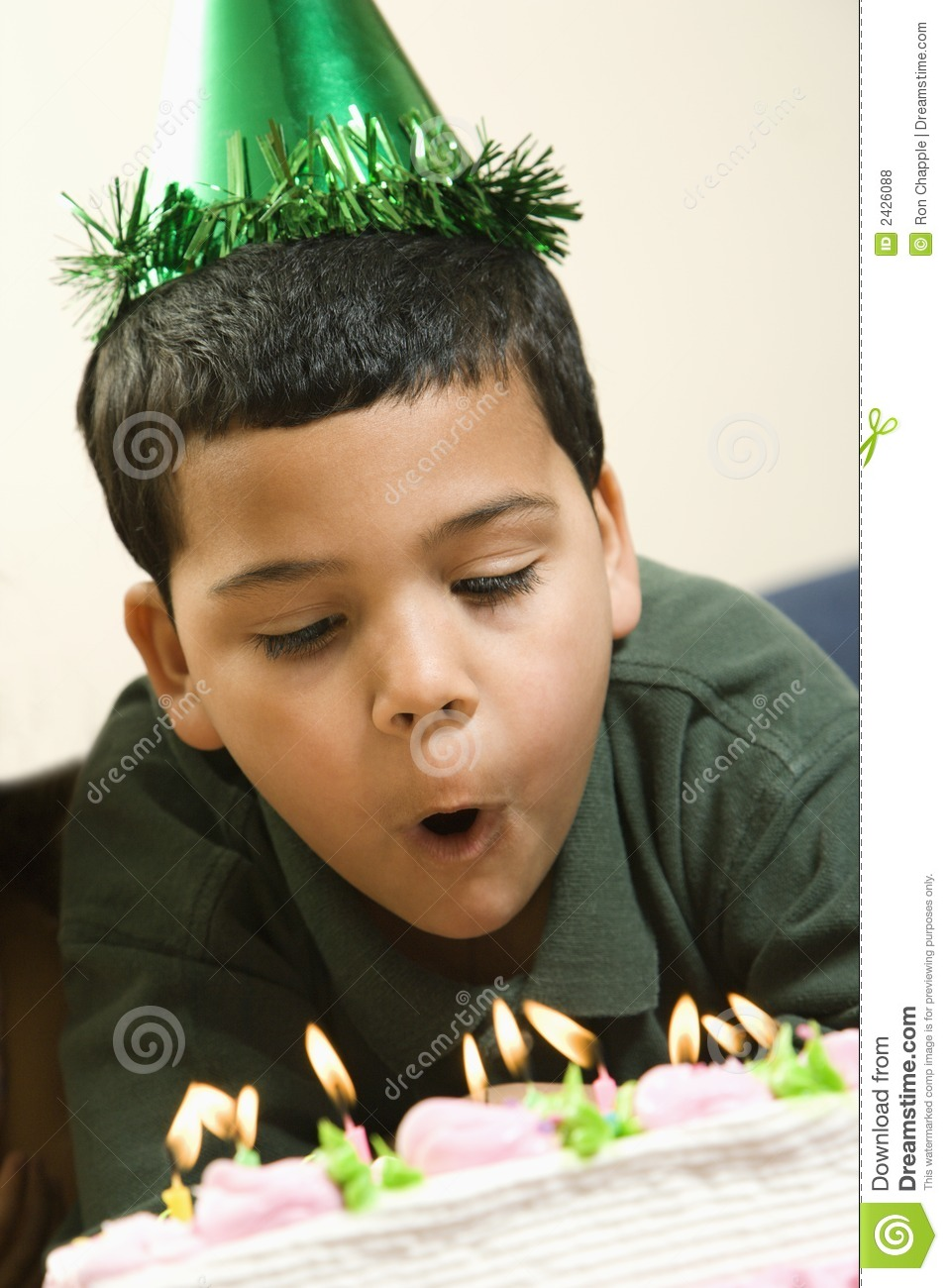 Boy Blowing Out Candles Stock Photo Image Of Candles