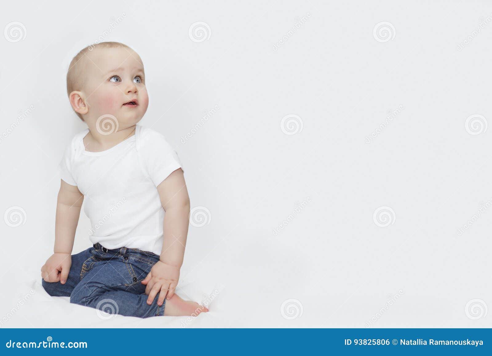 1b1cd80e91b A Boy With Blue Eyes In Jeans On A White Background Stock Photo ...