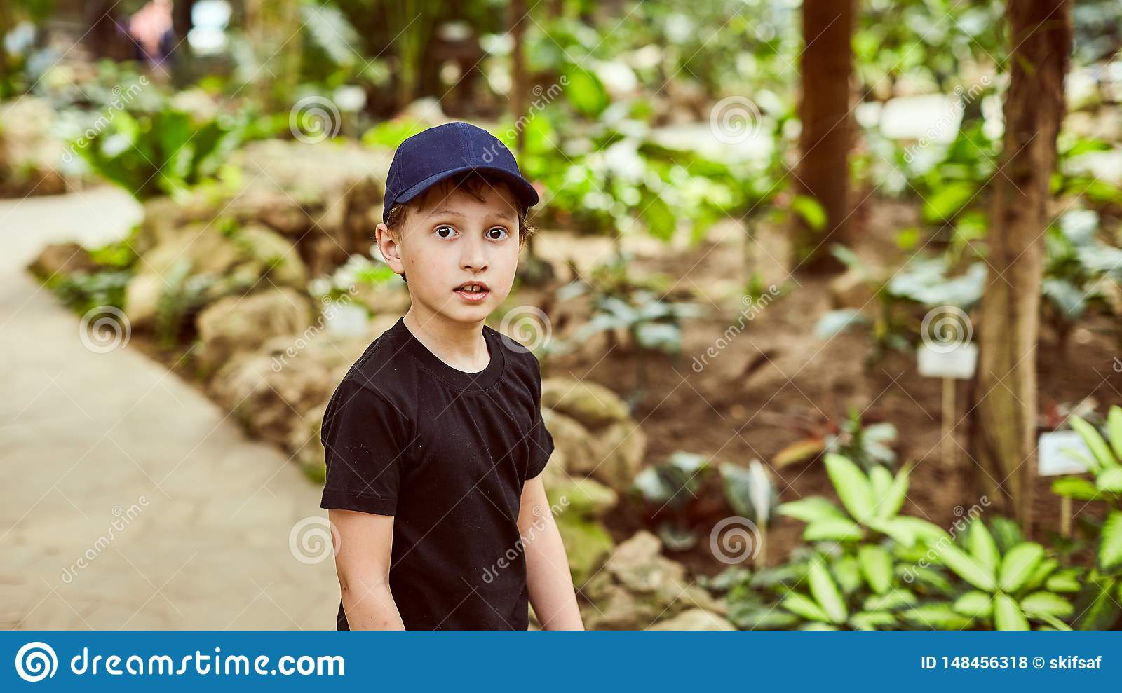 Boy in a cap in the summer outdoors in the Park