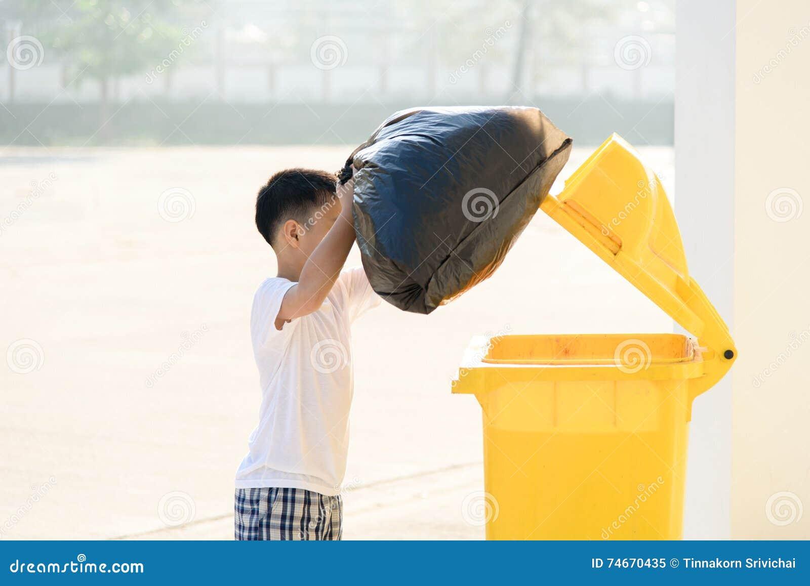 Boy carry garbage