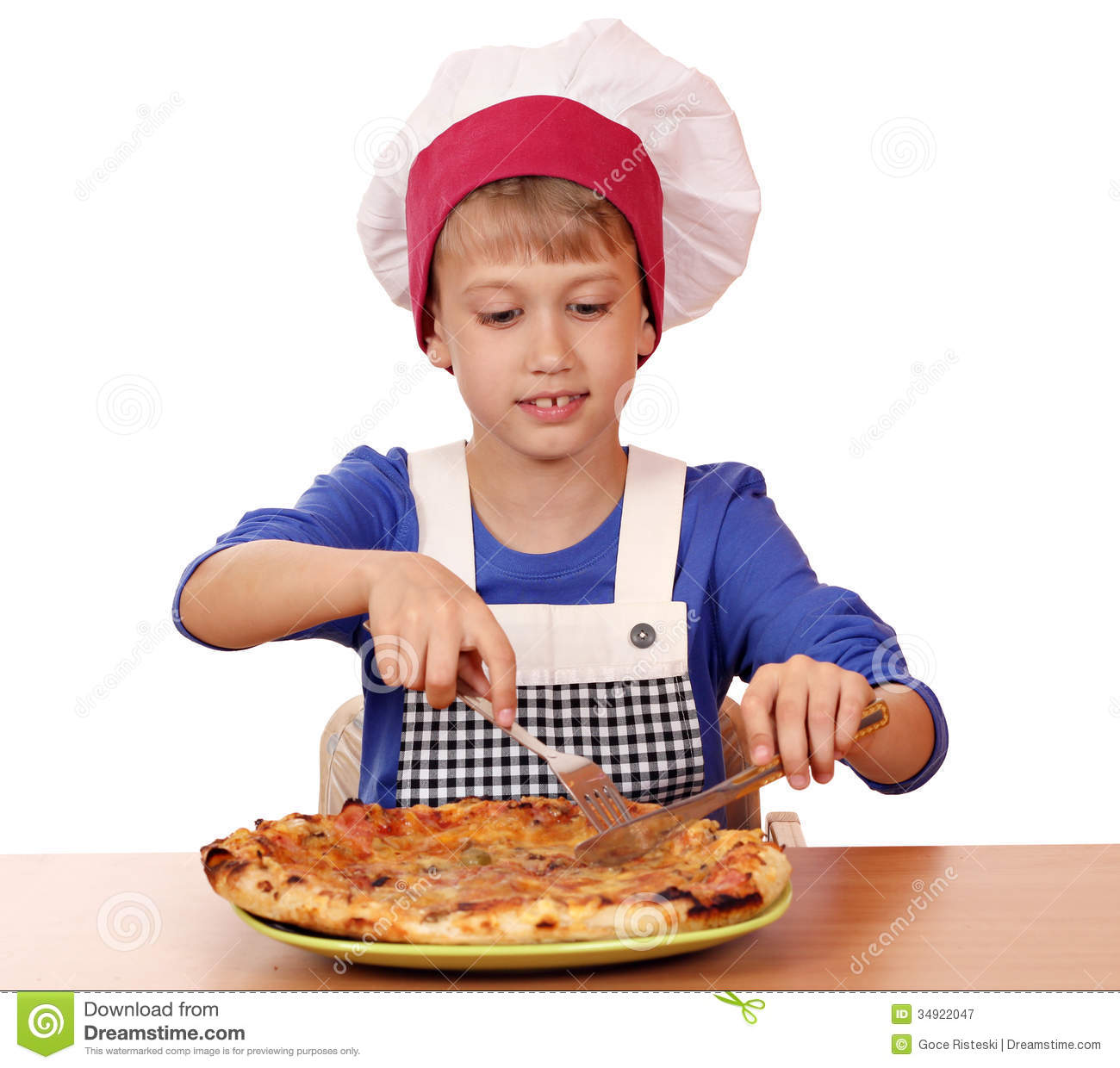Boy Chef Eat Pizza Royalty Free Stock Photography