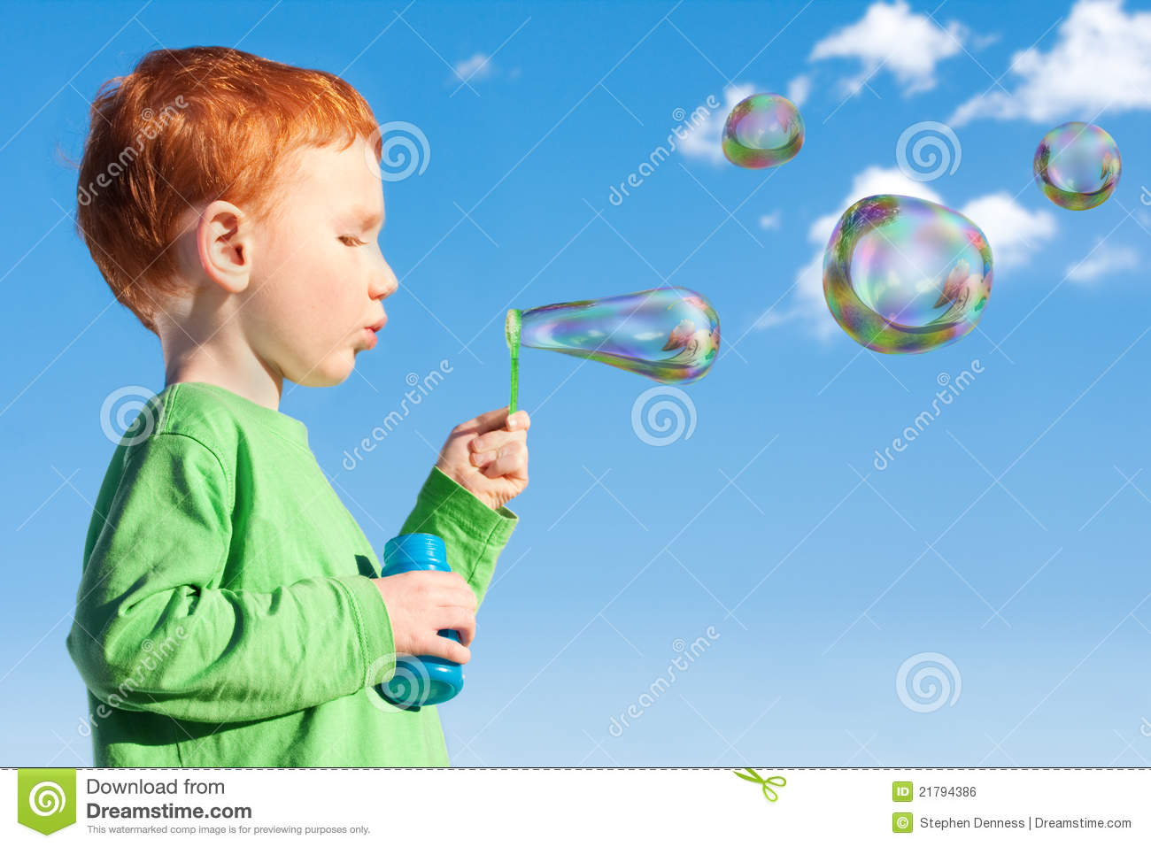 Boy Child Blowing Soap Bubbles Into Sky Royalty Free Stock
