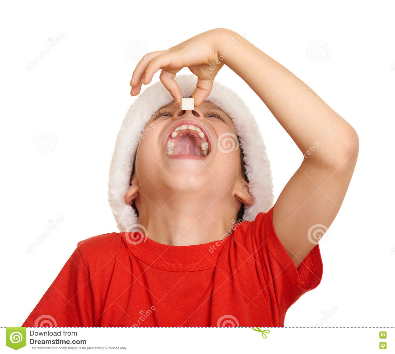 Boy child eat sugar in santa hat, having fun and emotions, winter holiday concept