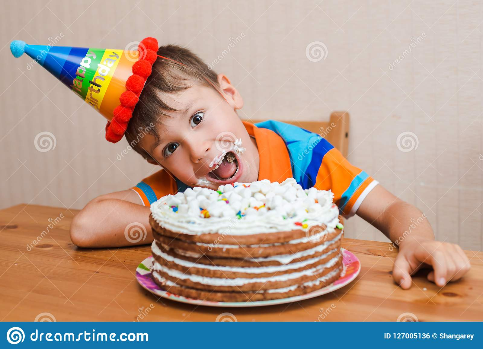 Admirable Boy The Child Is Eating His Birthday Cake Stock Photo Image Of Funny Birthday Cards Online Inifofree Goldxyz