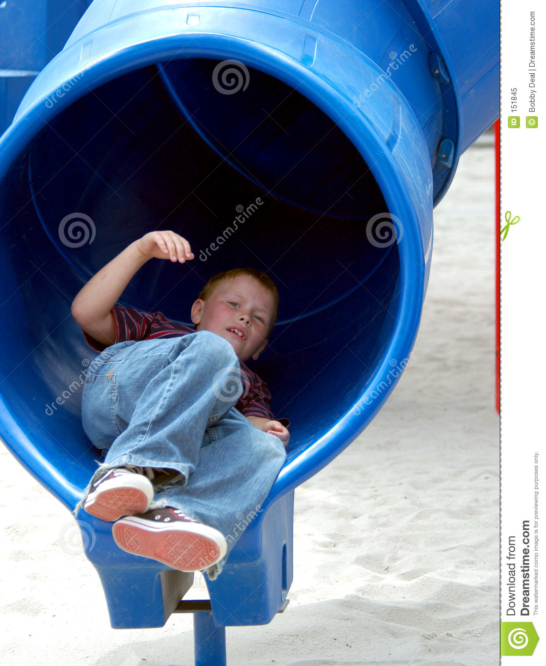 Boy Child In Tube Slide