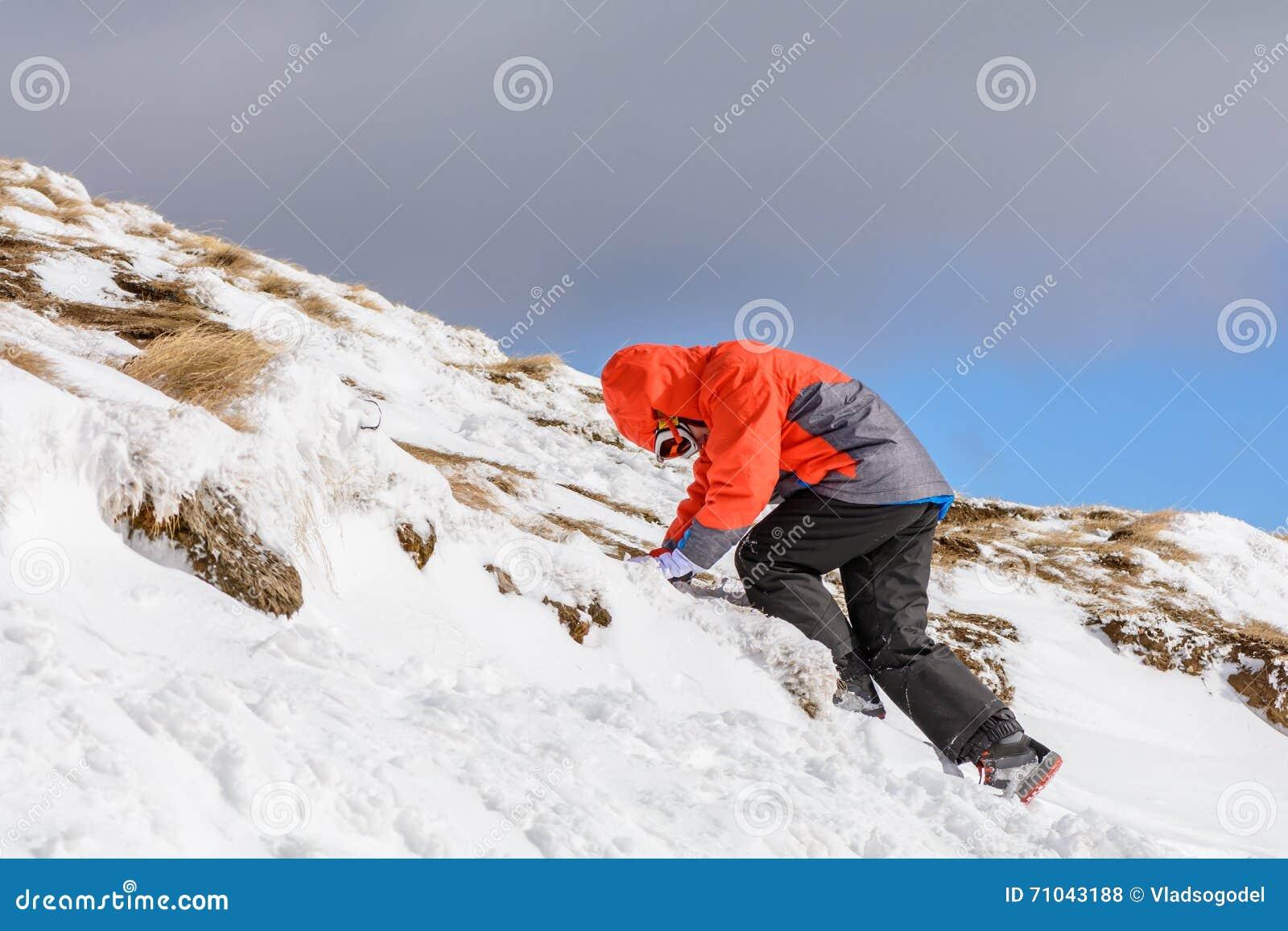 6b9a8dac3497 Boy Climbing On Mountain In Wintertime. Cute Little Kid Boy In C ...