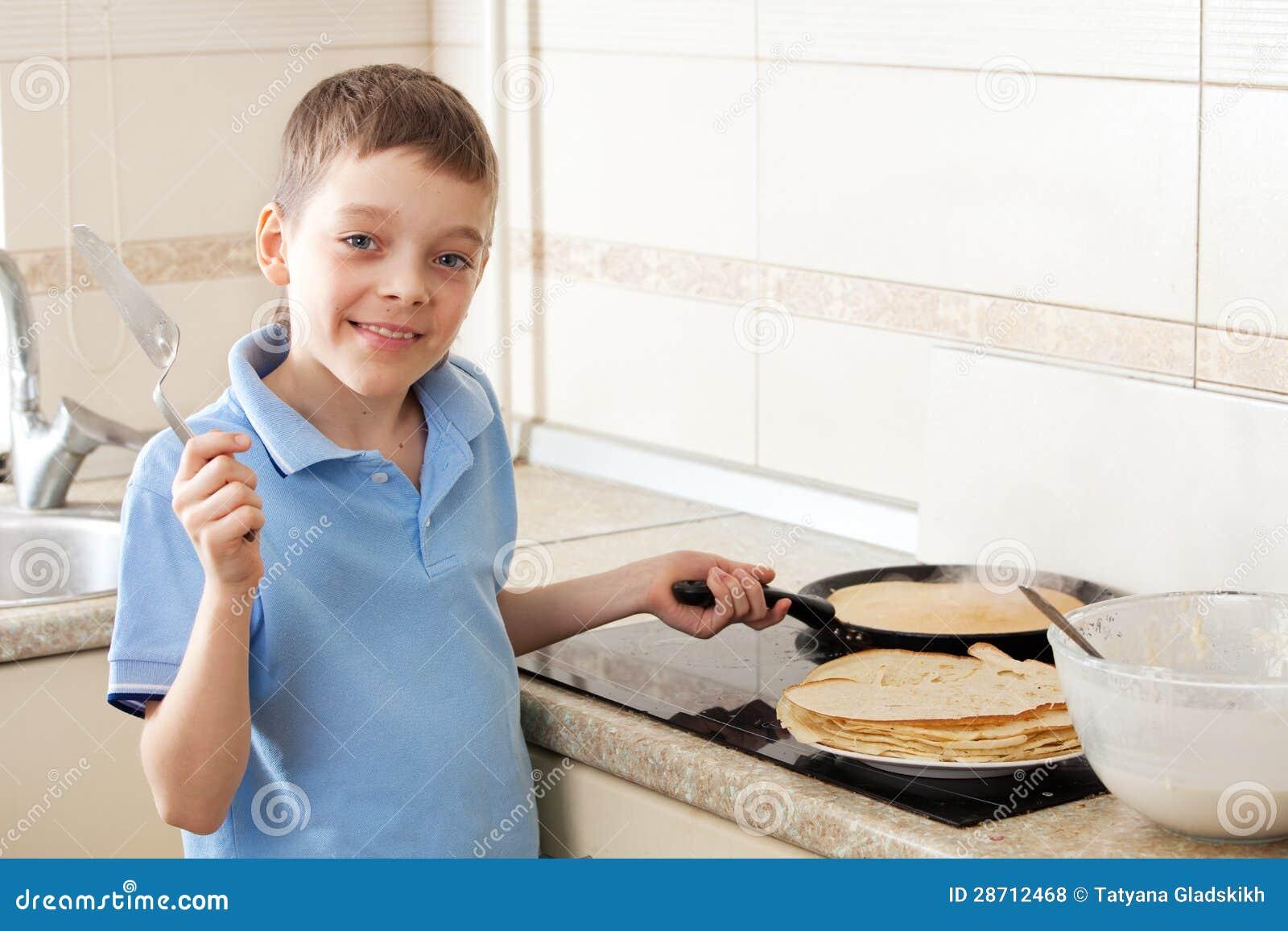 Boy Cooking Boy cooking pancakes