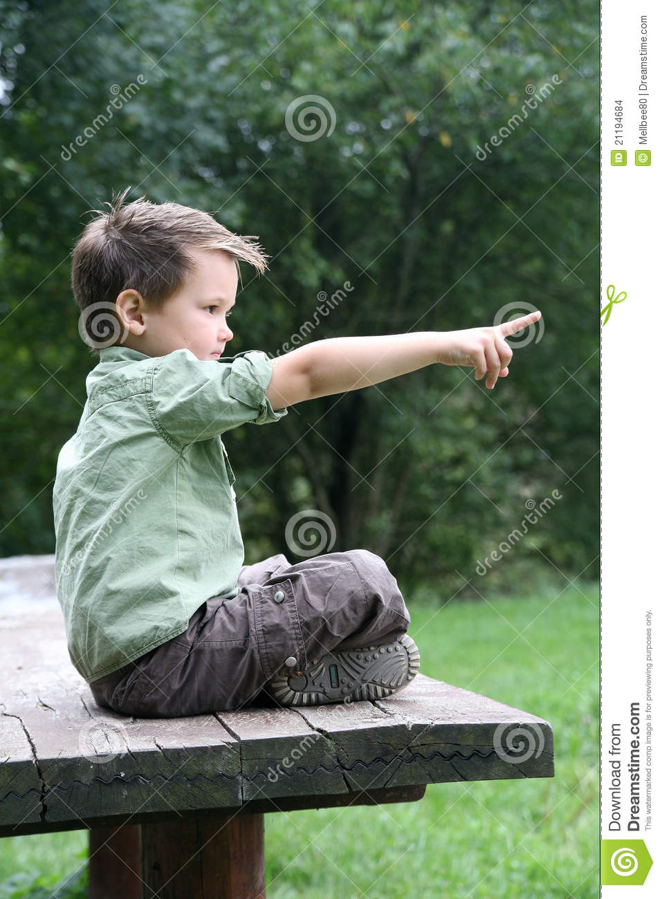 Boy Cross Legged On A Wooden Bench Stock Photo Image Of