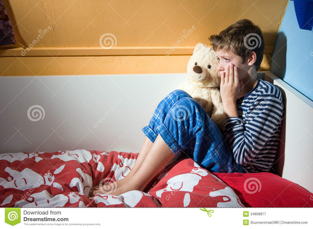 Boy Crying On His Bed Royalty Free Stock Photography - Image: 34808877