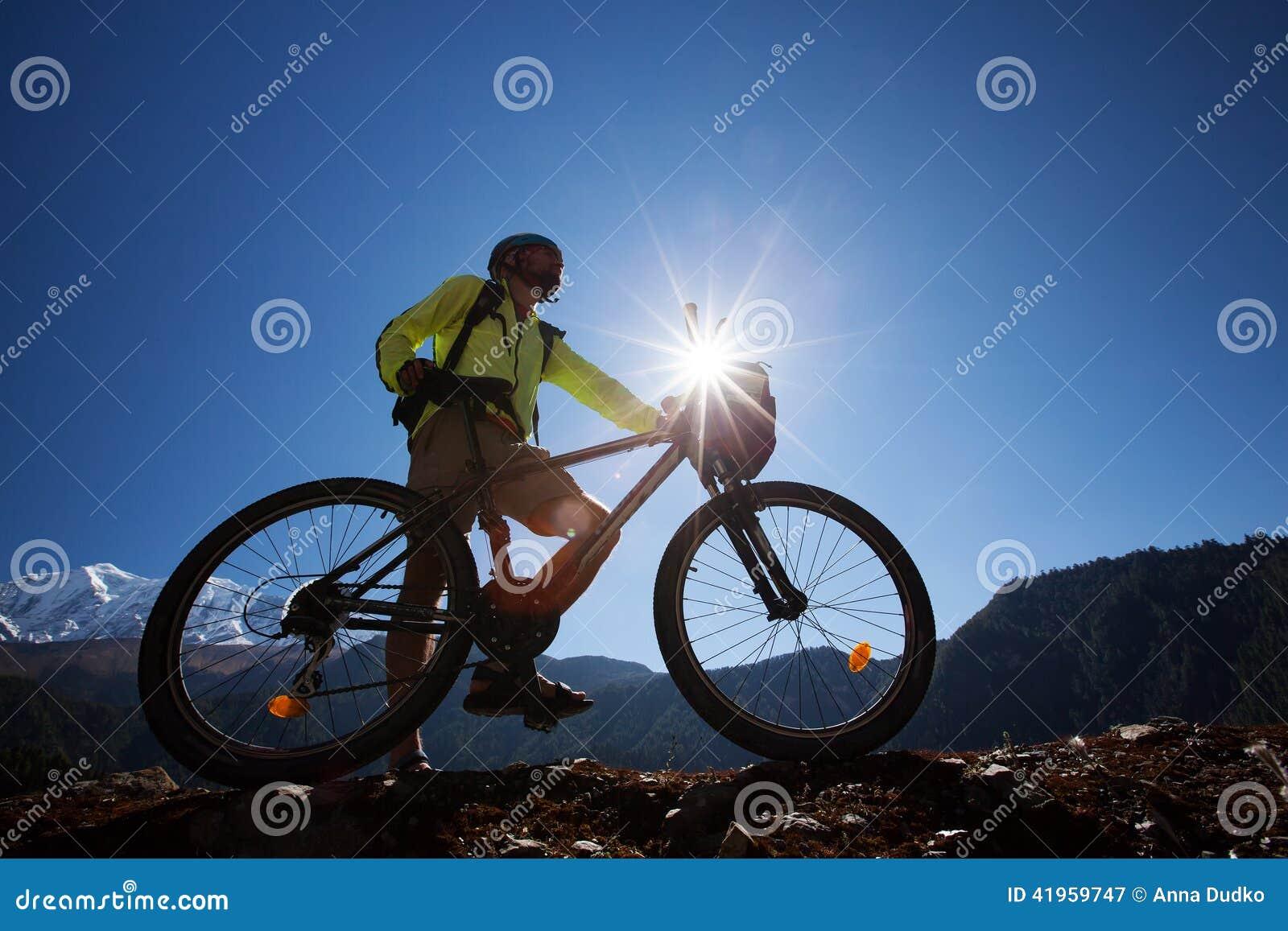Boy cycling at the road