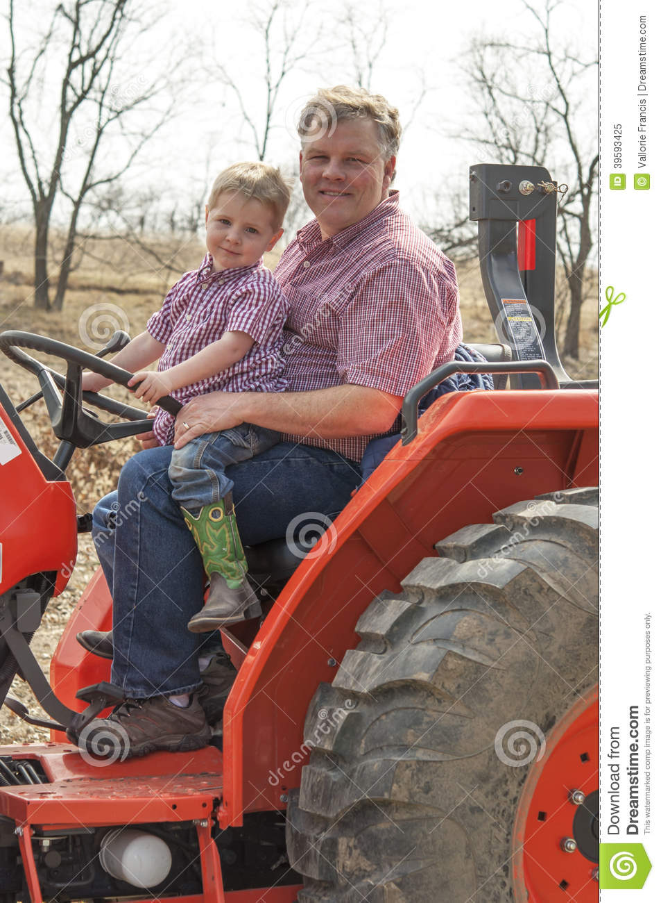 Boy On Tractor : Royalty free stock photo boy and dad sitting on tractor