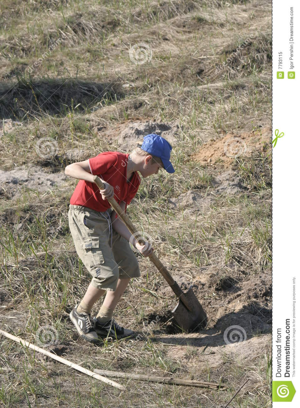 Boy digging in field stock image image of digs field for Digging ground dream meaning