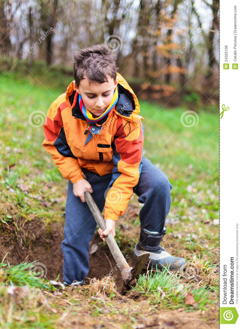 Boy digging in the ground stock photo image of lawn for Digging ground dream meaning