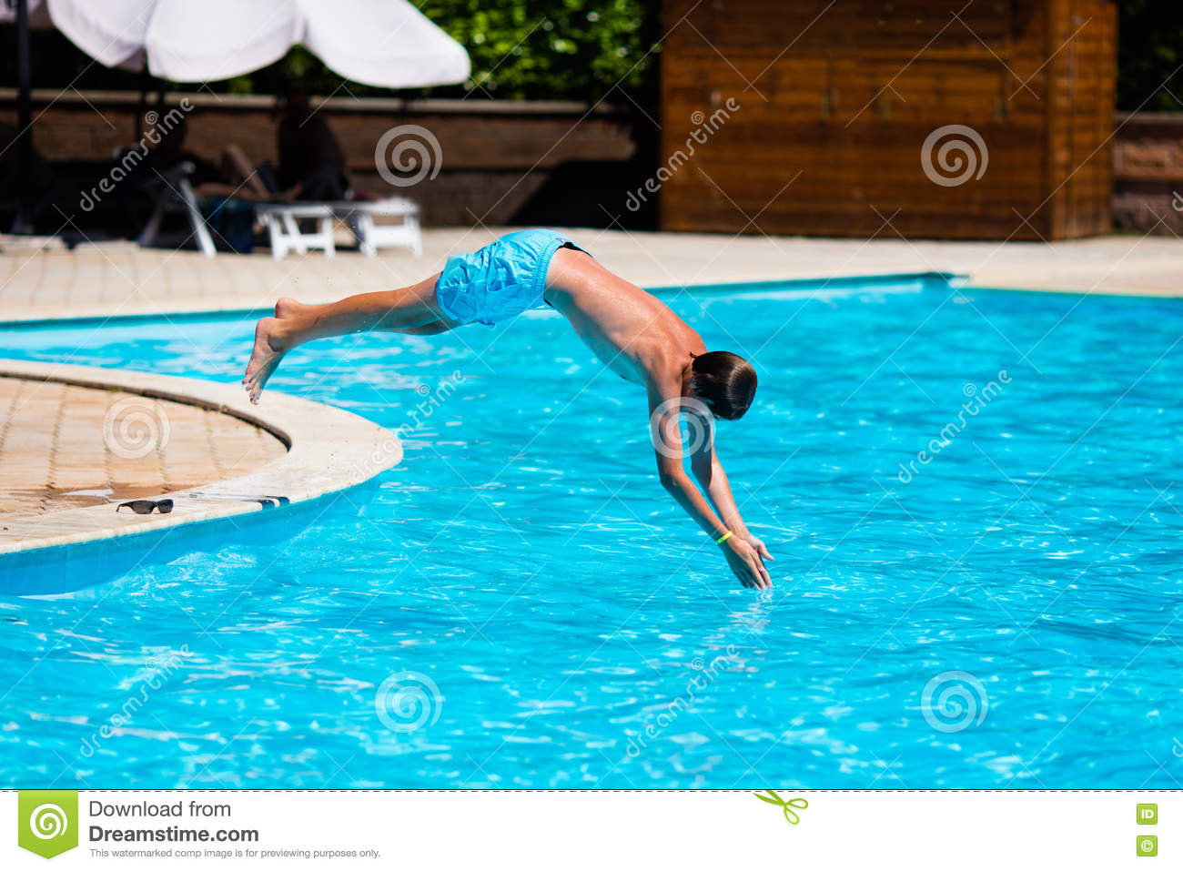 Boy Diving In Swimming Pool Stock Photo Image Of Family School 76577156