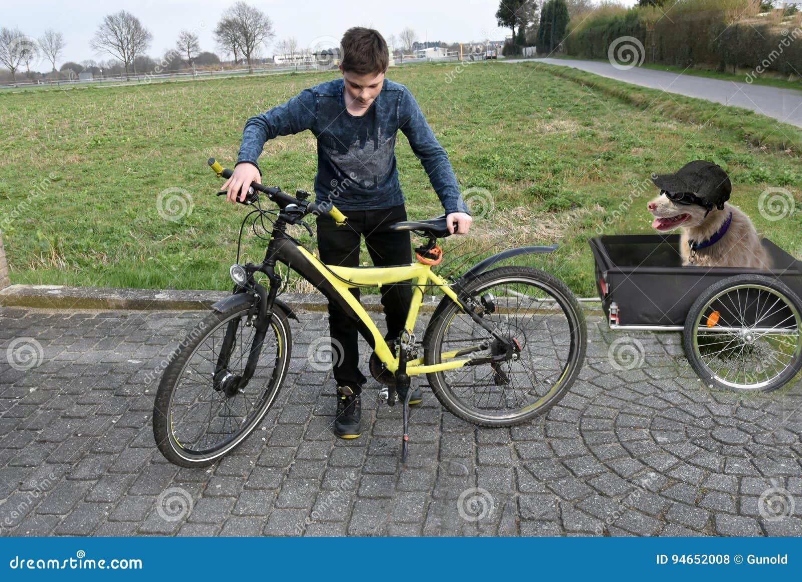 Boy and dog making a trip