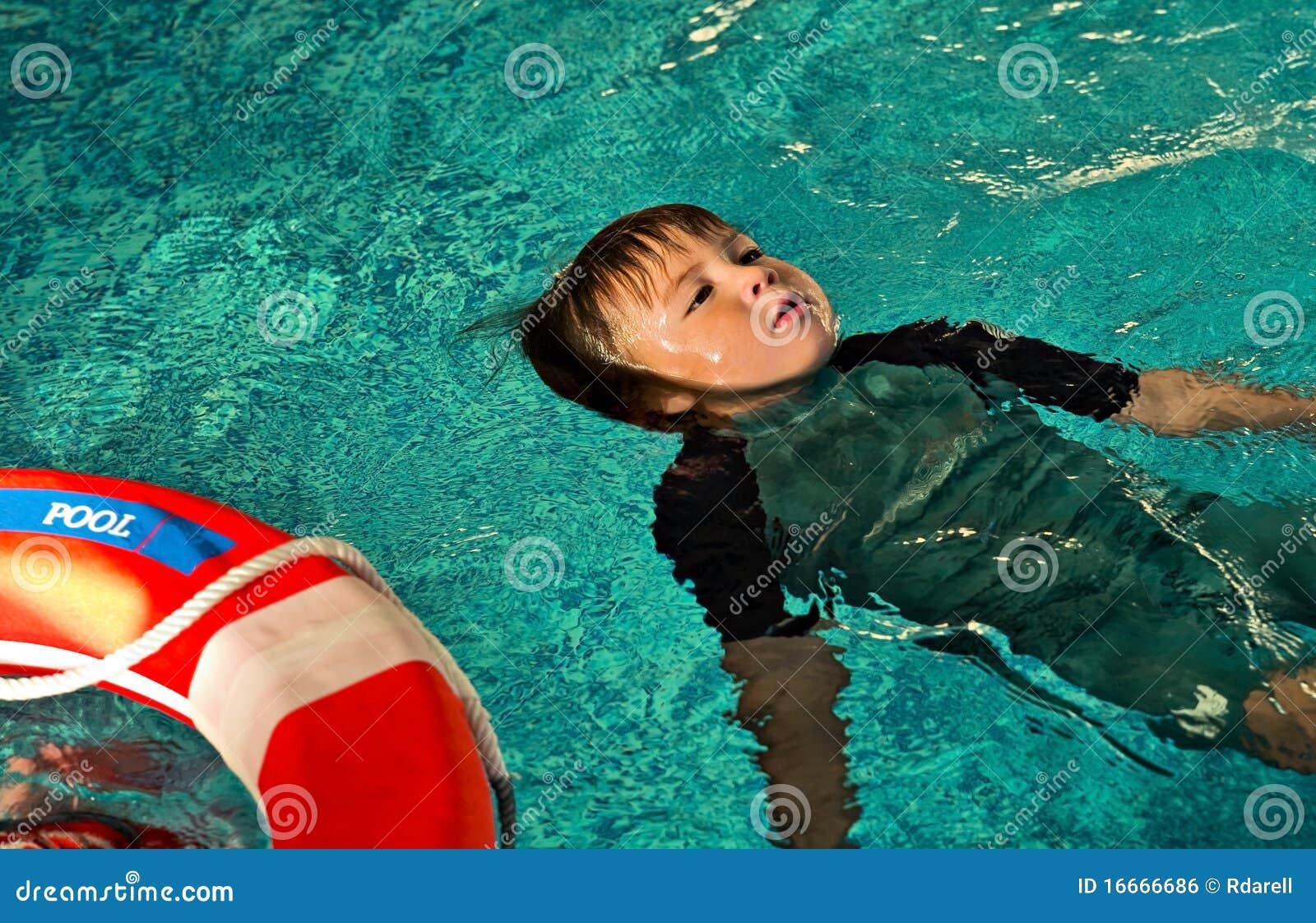 Boy Doing Lifesaving Floating On Water Stock Photo