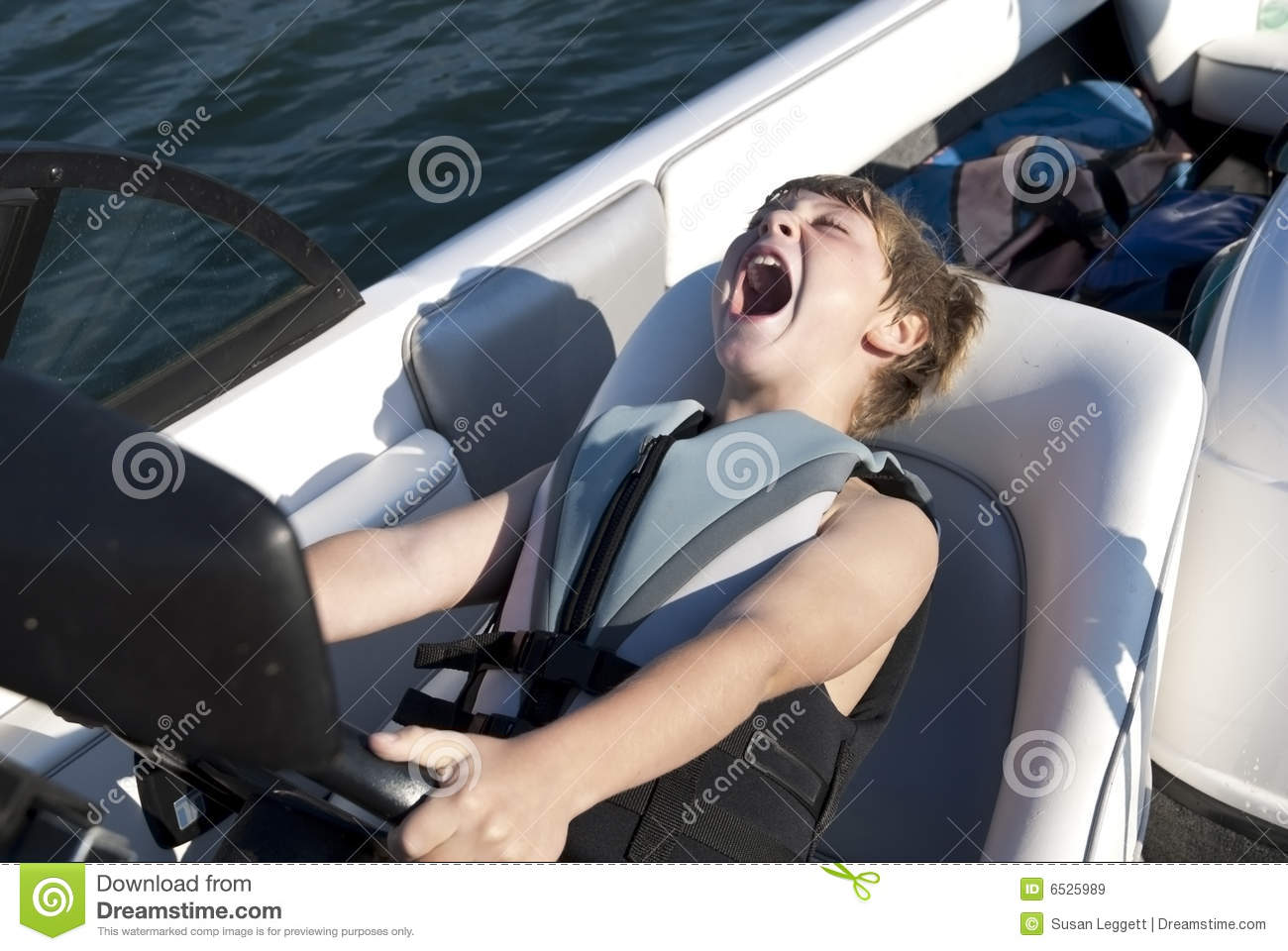 Boy Driving Ski Boat Fast Royalty Free Stock Images - Image: 6525989