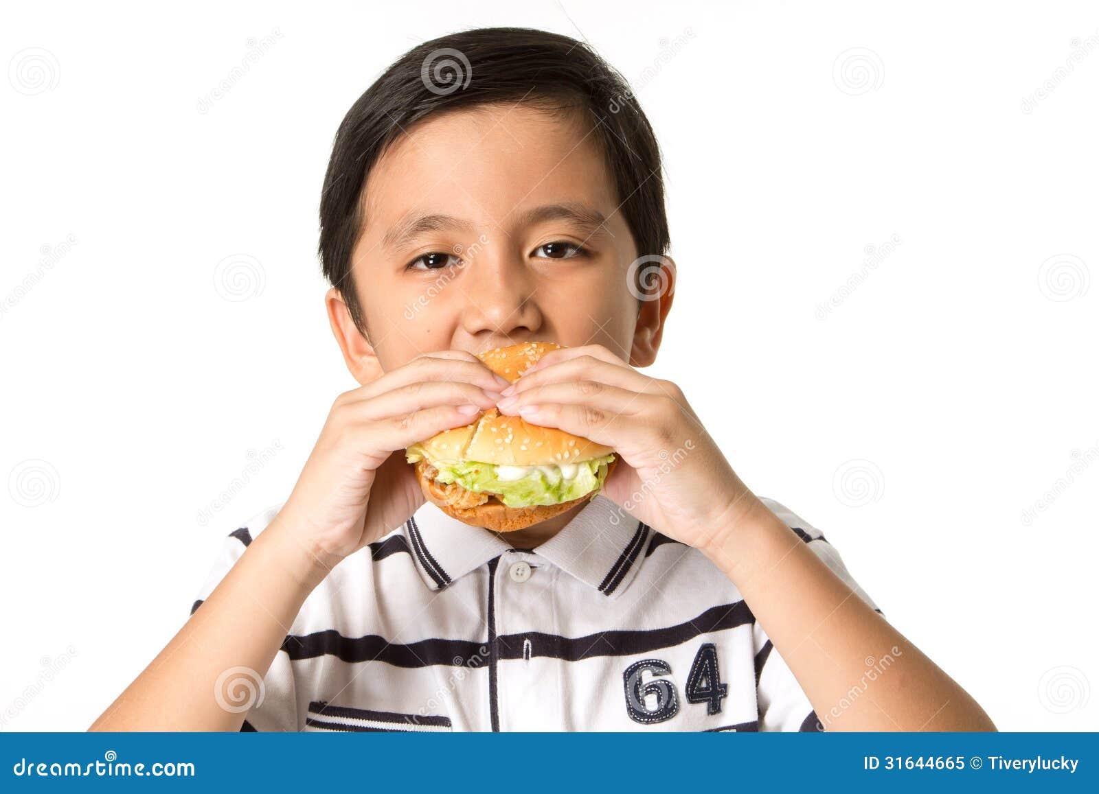 Boy Eating A Burger Royalty Free Stock Photo - Image: 31644665