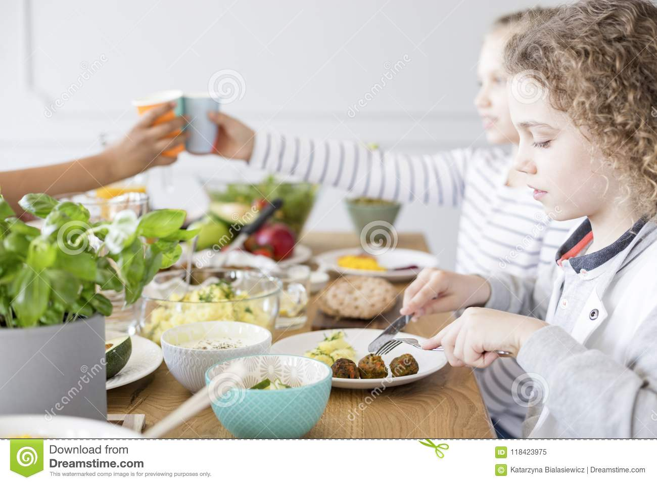 Boy Eating Falafel During Birthday Party At Home. Healthy Diet F ...