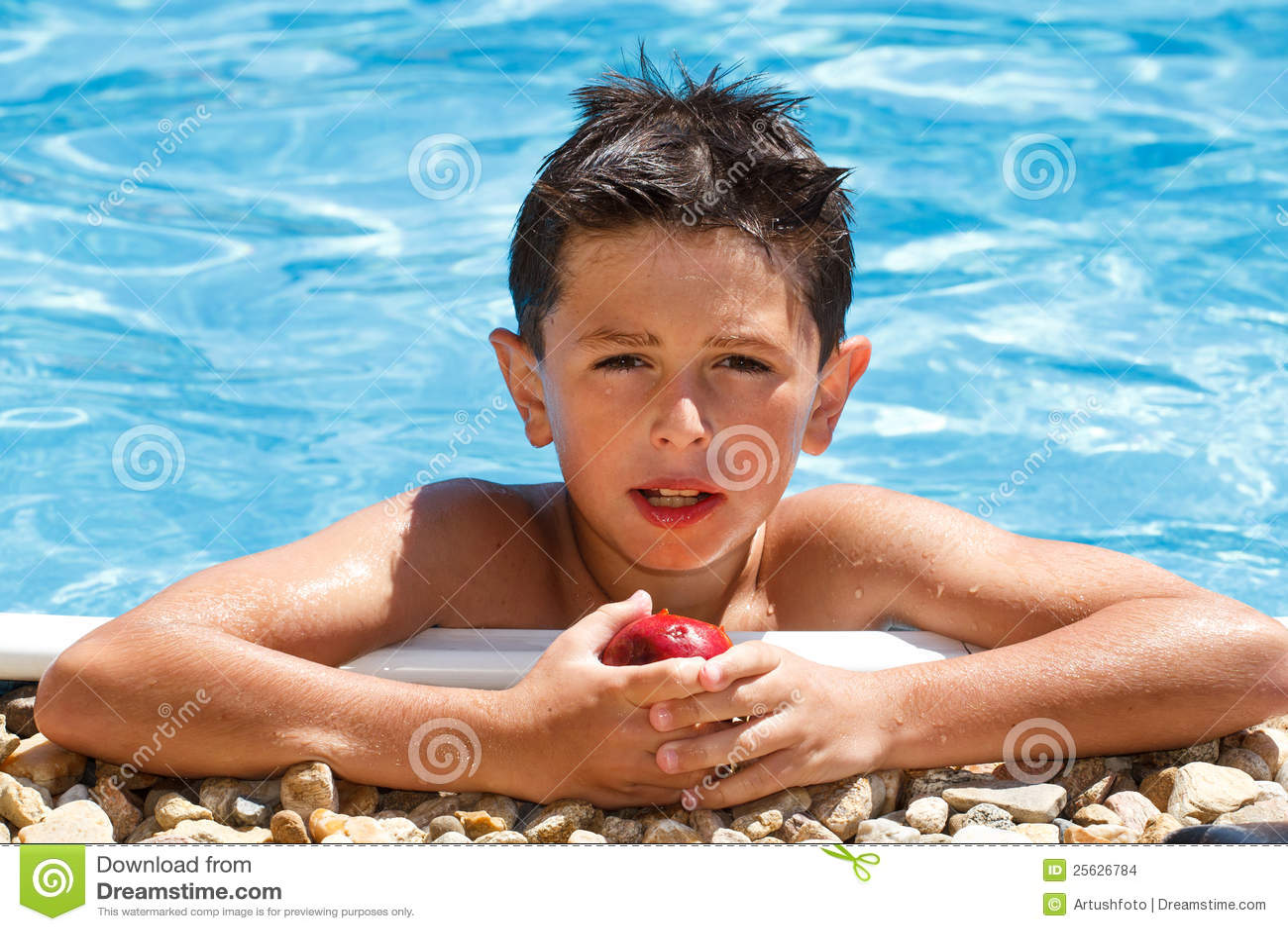 Boy Eating Fruit In Swimming Pool Stock Photo - Image of ...