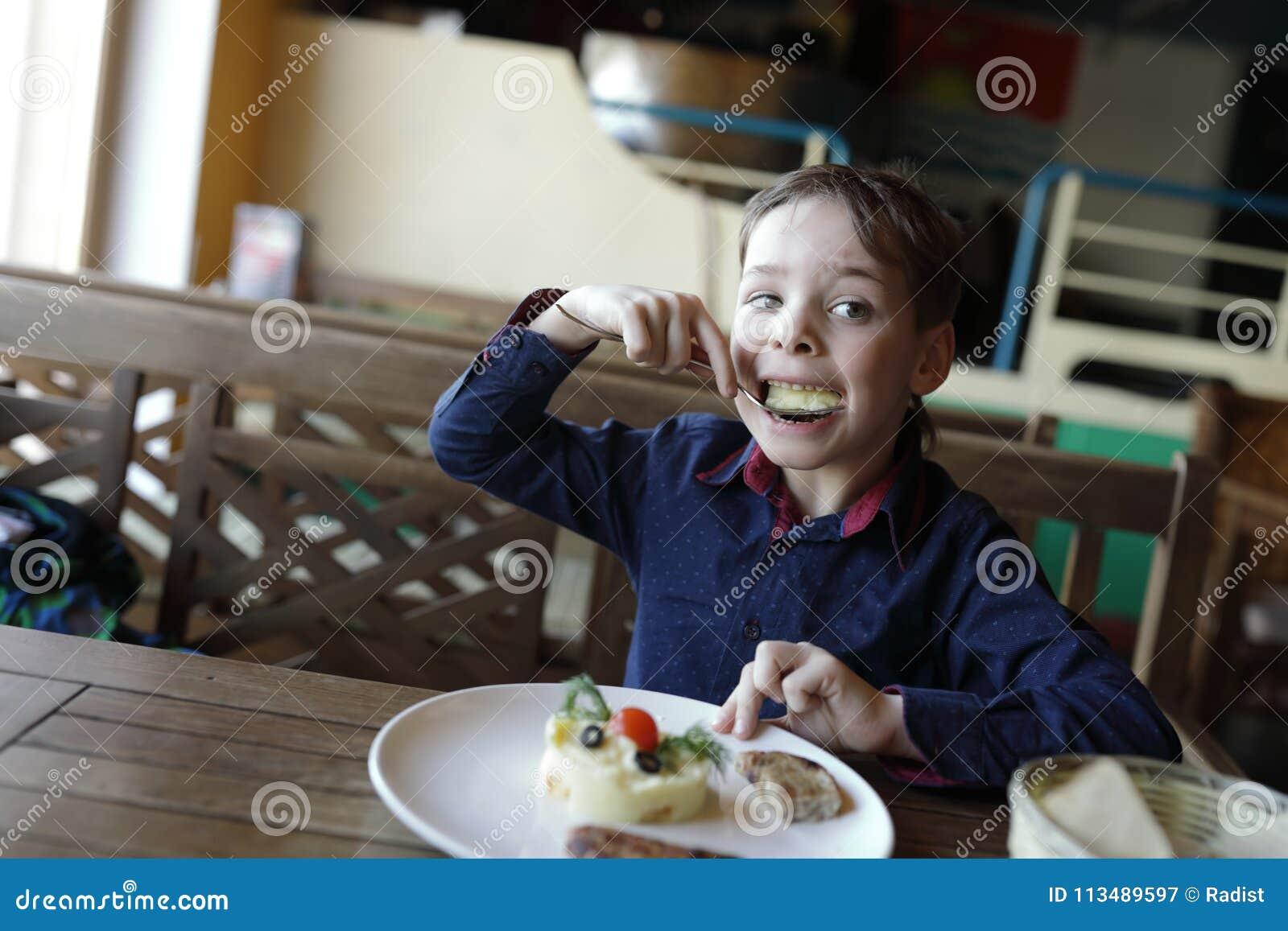 Boy Eating Mashed Potatoes