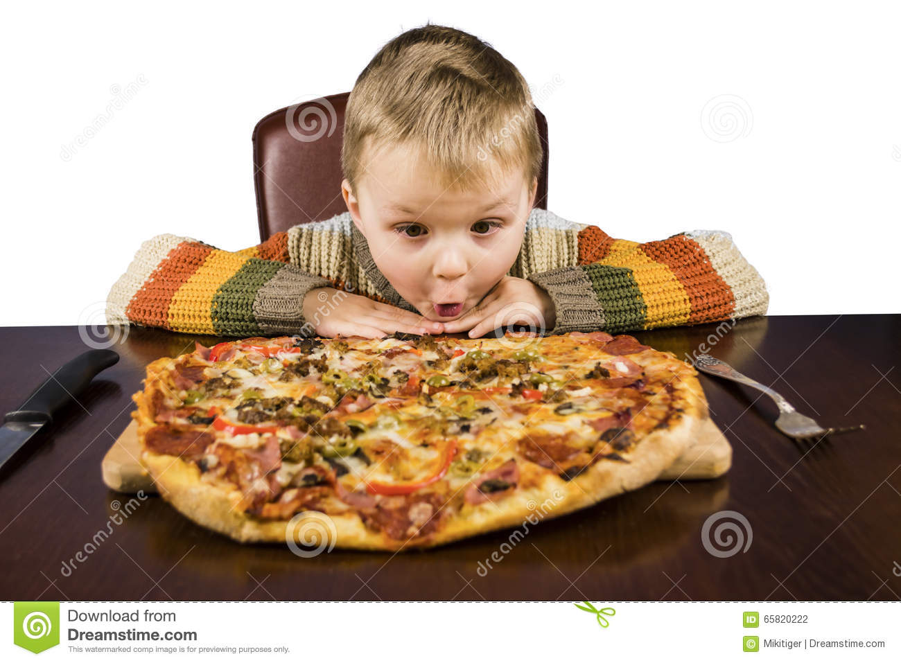 Boy eating pizza stock photo image of surprise large for Eating table