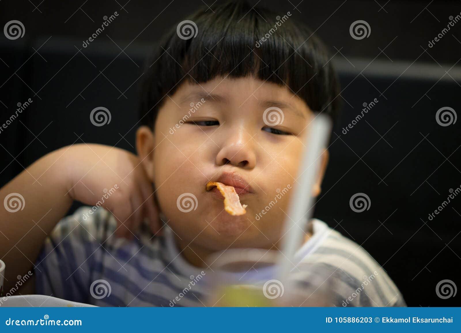 A Boy Eats Bacon Stock Image Image Of Eats Face Asia 105886203
