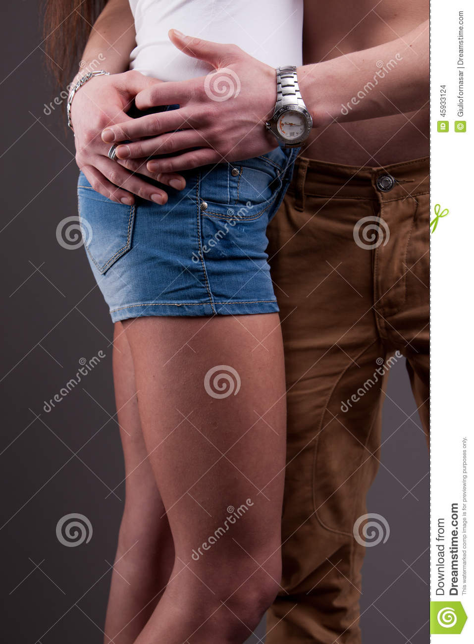 Girl with hand in mans pants