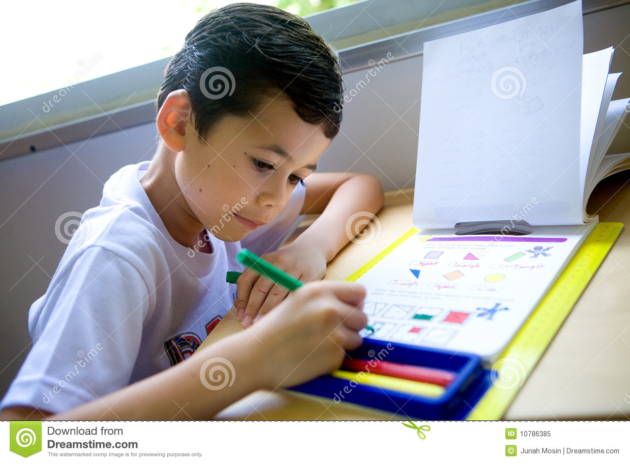 https://thumbs.dreamstime.com/z/boy-engross-doing-his-math-coloring-homework-10786385.jpg