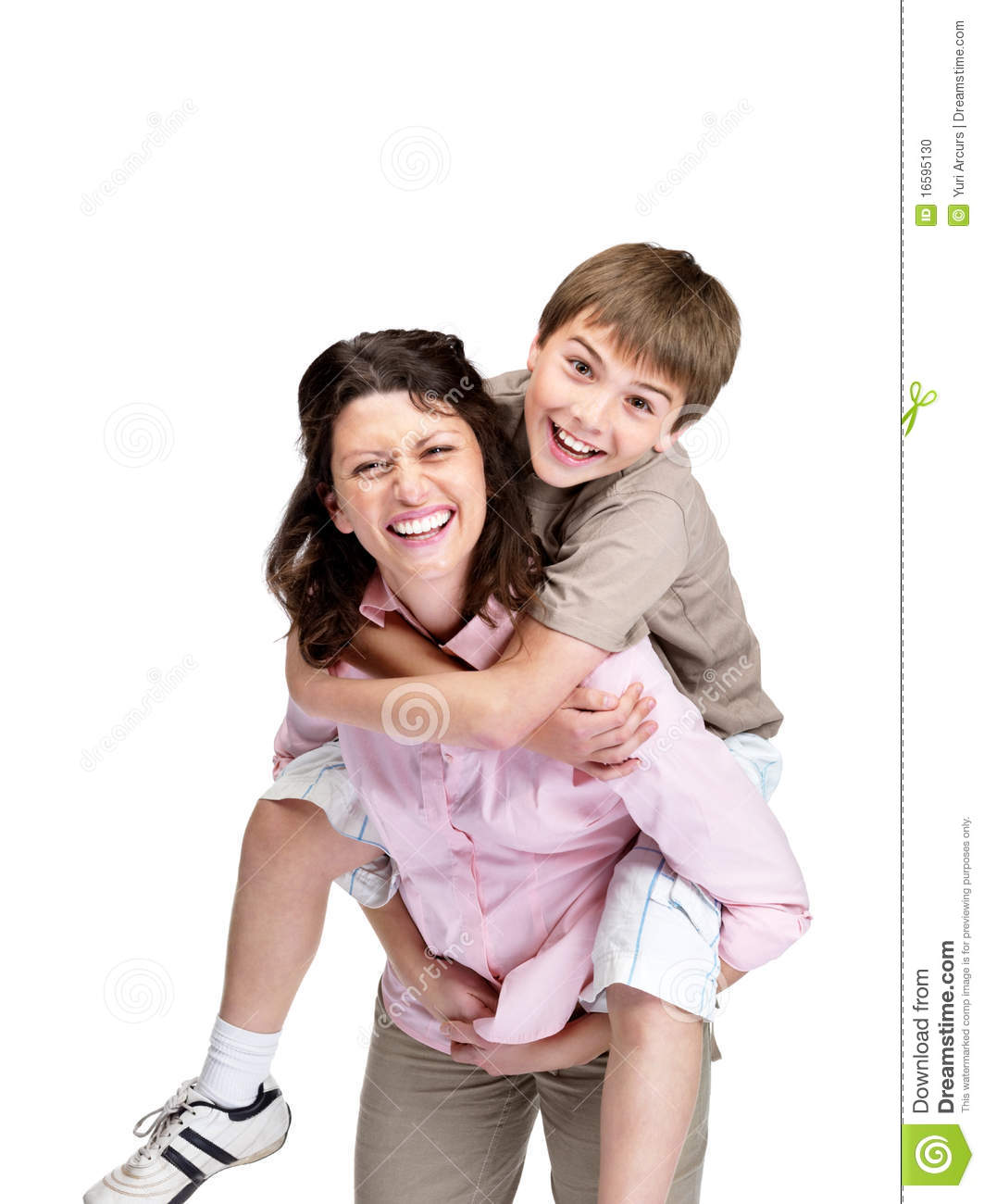 Family Enjoying Time Together On Beautiful Foggy Beach: Boy Enjoying Piggyback Ride On His Mother's Back Stock