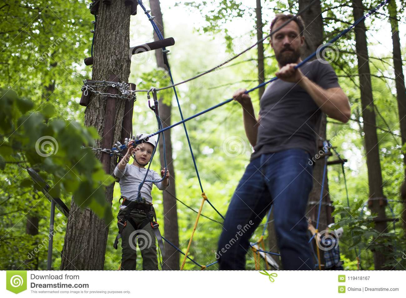 Boy Enjoys Climbing In The Ropes Course Adventure Smiling Child Space Wire Harness Engaged High Park Copy For Your Text