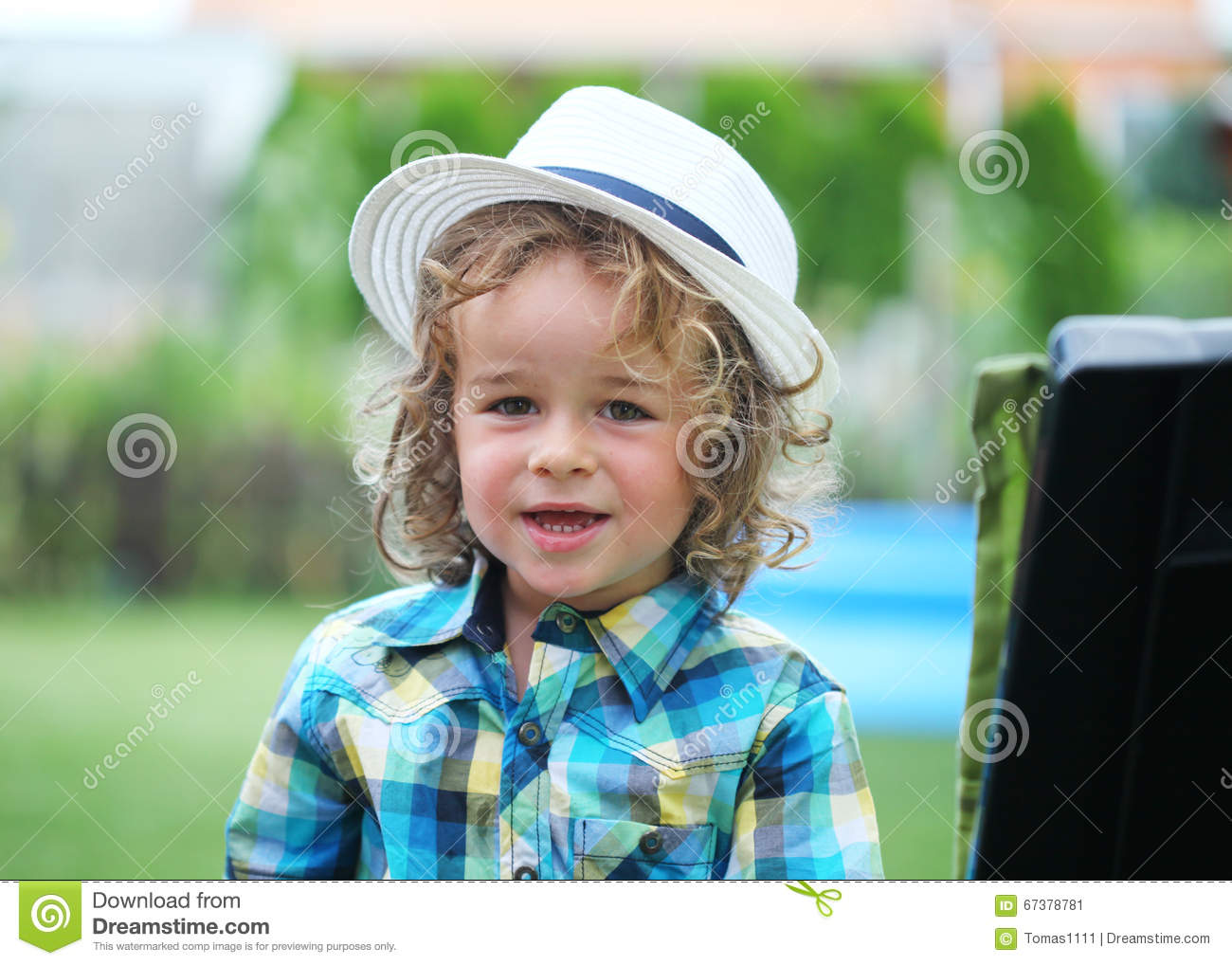 Boy with fashion hat in nature