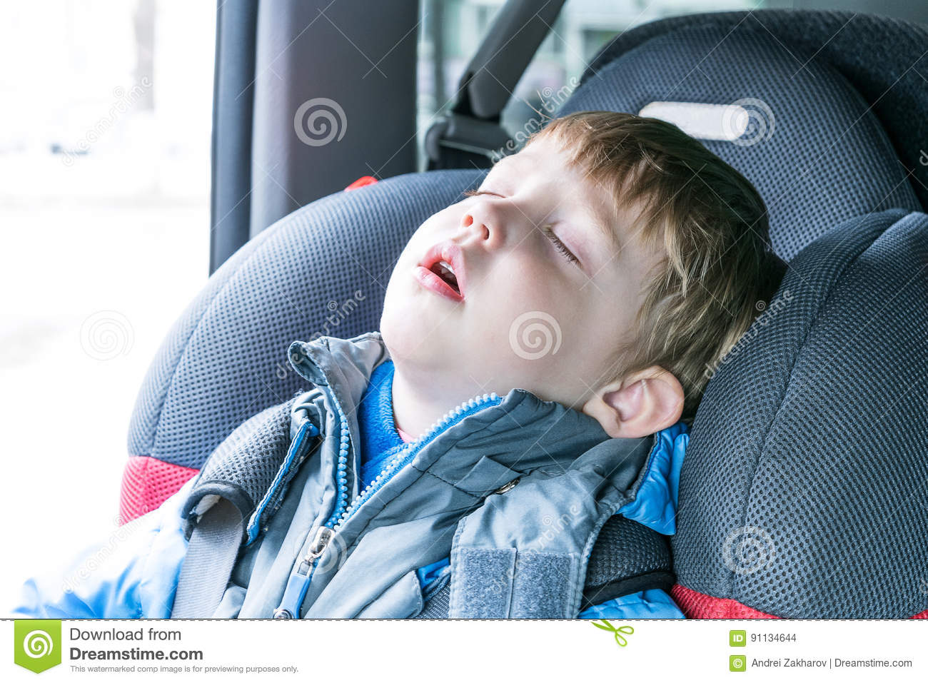 The Boy Fell Asleep In The Car Child Seat. Stock Photo ...