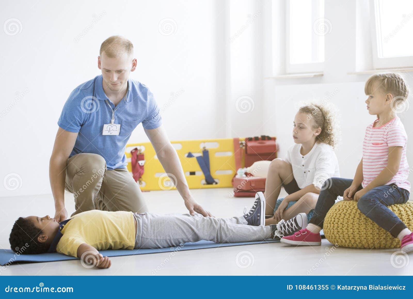 Boy during first aid training