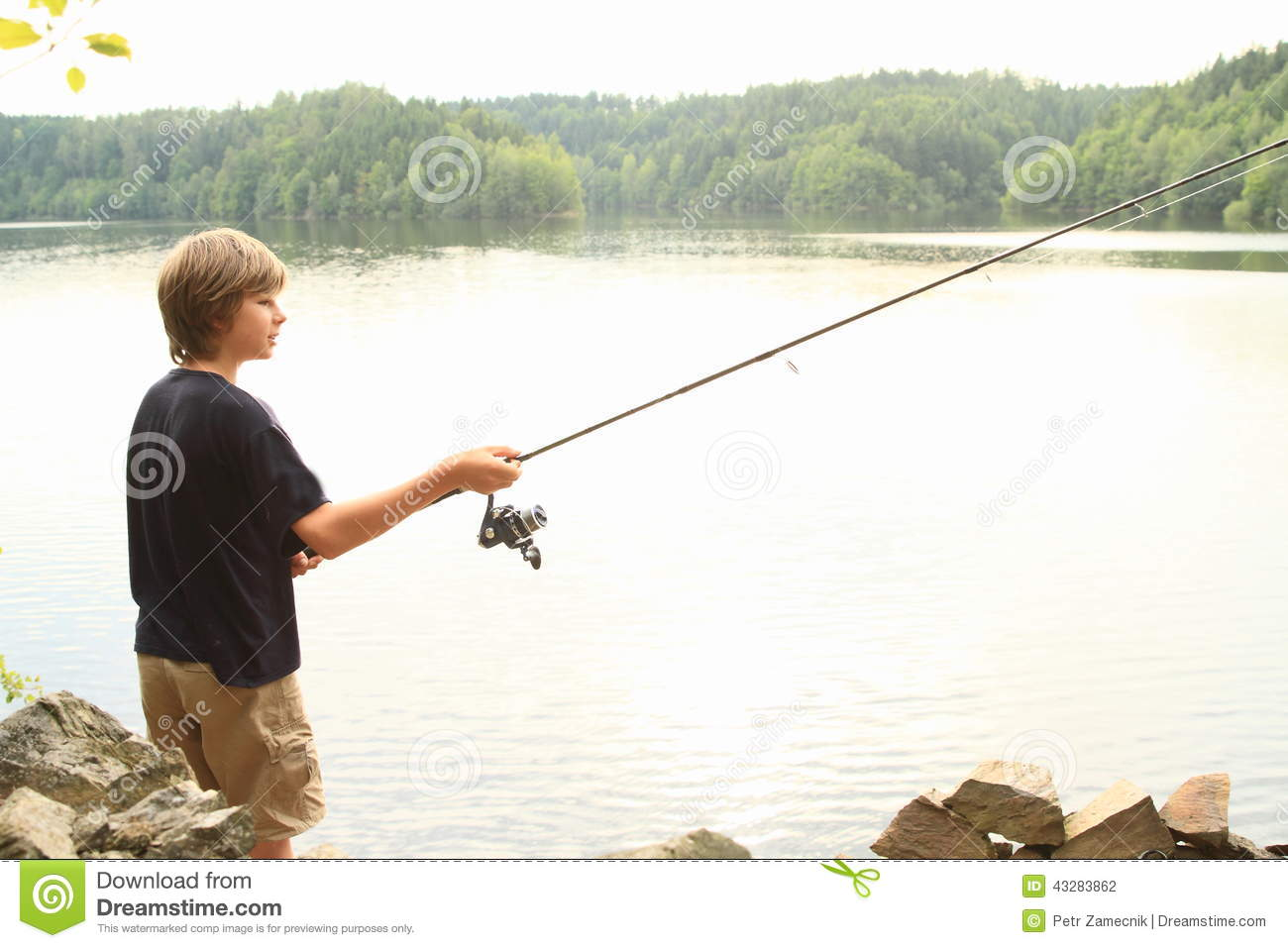 Boy fishing on lake stock photo image of lake forest for Little boy fishing
