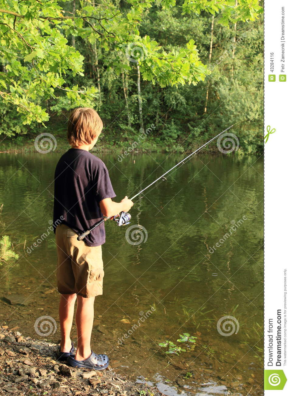 Boy fishing on lake stock photo image 43284116 for Little boy fishing