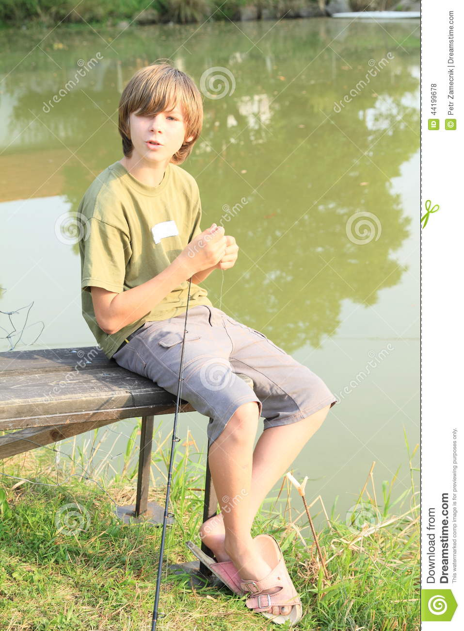 Boy fishing on pond stock photo image 44199678 for Small pond fishing