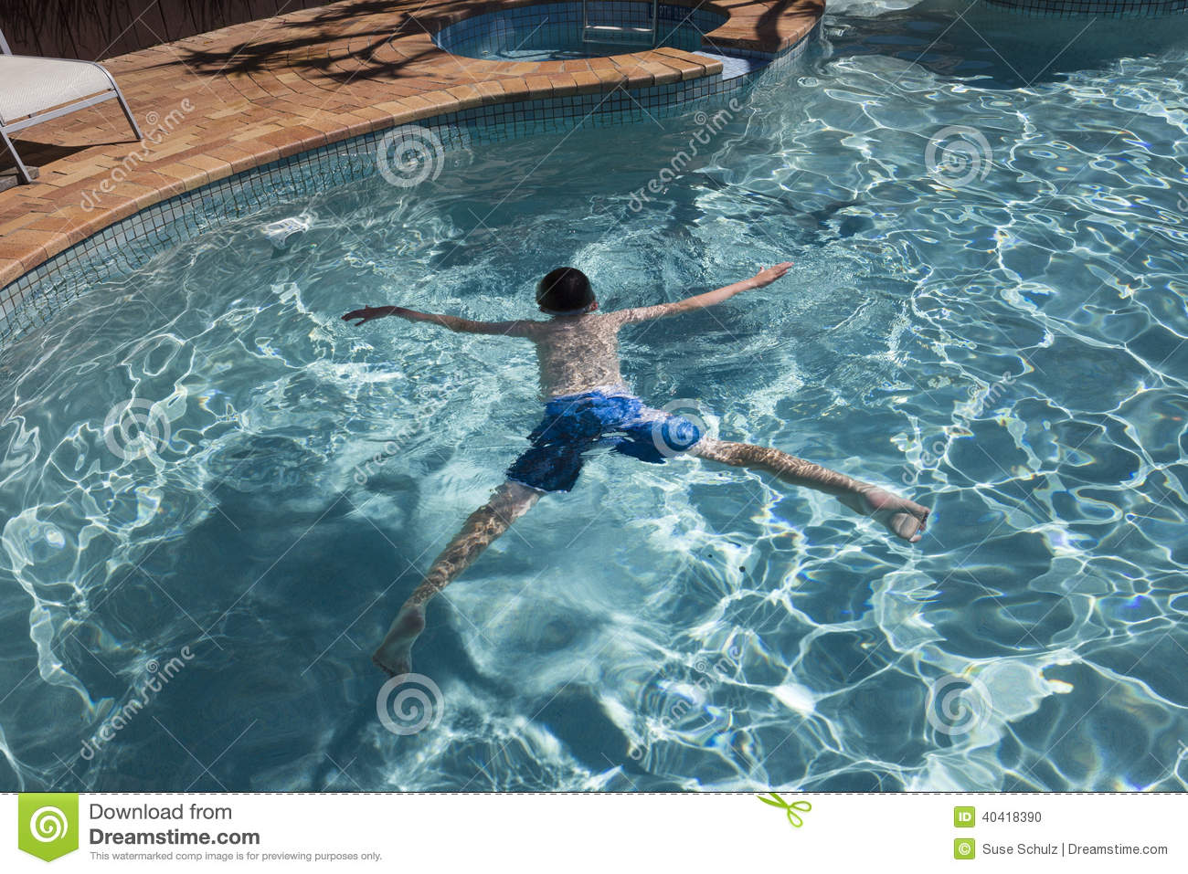Boy Floating In Swimmingpool Stock Photo - Image: 40418390