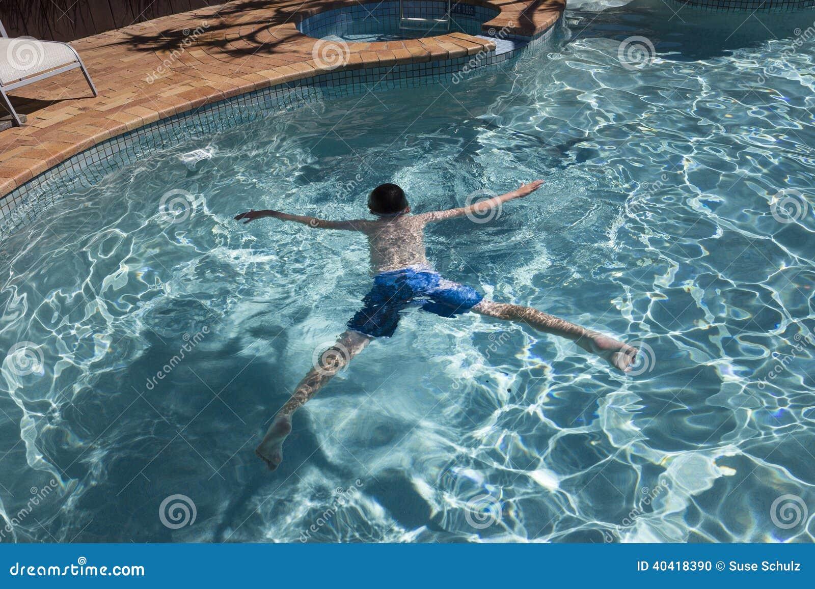 Boy Floating In Swimmingpool Stock Photo Image 40418390