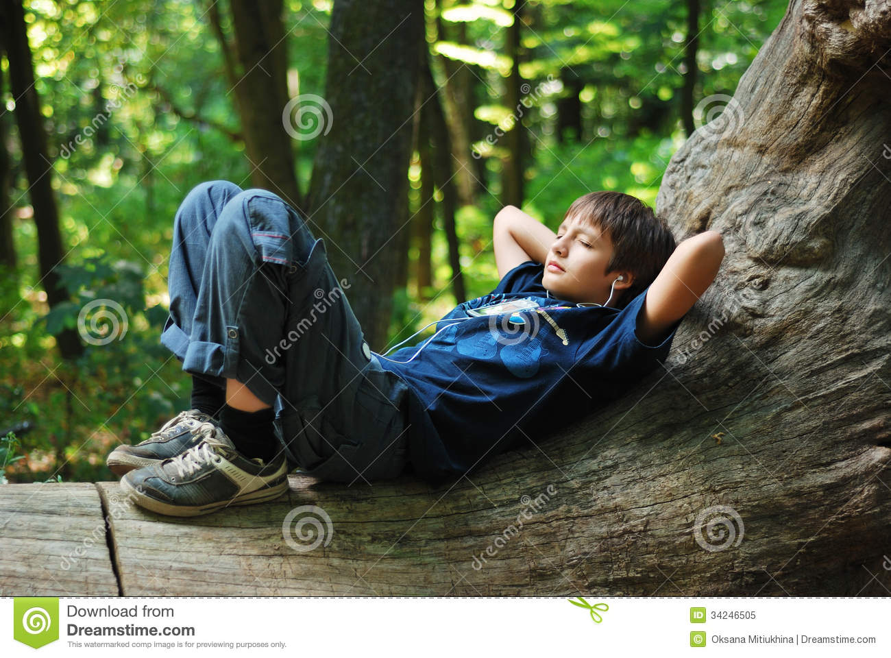 Boy with gadget in forest stock image. Image of caucasian ...