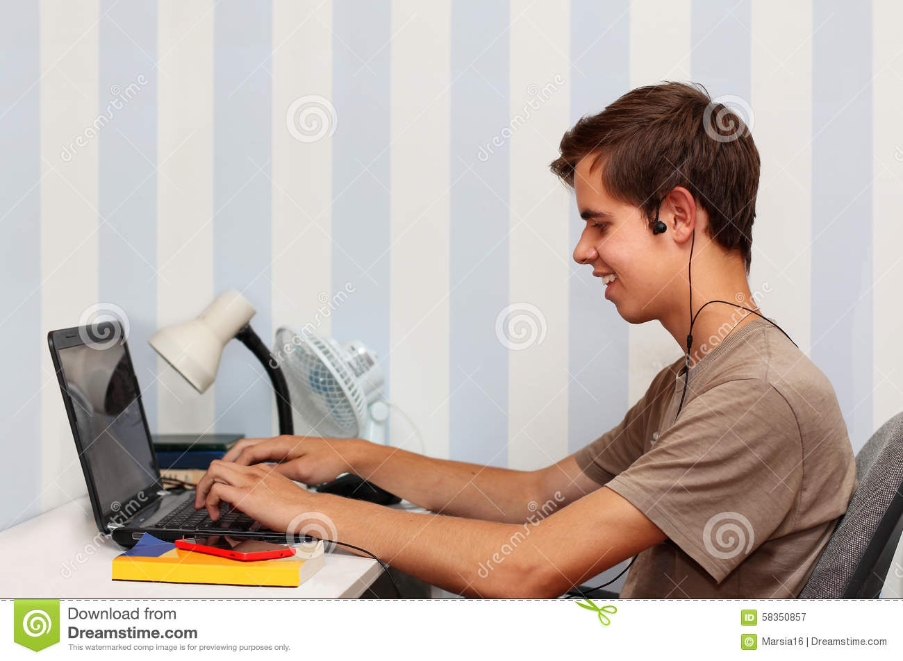 Teenage Boy With The Virtual World Of Internet. Stock Image - Image
